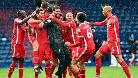 Liverpool goalkeeper Alisson celebrates scoring injury-time winner at West Brom to keep their top-four hopes alive. Picture by Laurence Griffiths/PA