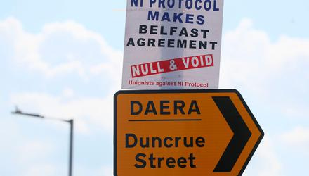 A protest sign close to the Department of Agricultural, Environment and Rural Affairs facility near Belfast Harbour. Photo: PA