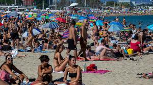 Packed: People enjoy the beach in Barcelona, despite the concerns about social distancing. Photo: Emilio Morenatti/AP