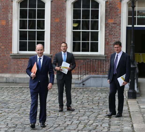 Hanging together: Coalition party leaders (from the                 left) Micheál Martin, Leo Varadkar and Eamon Ryan.                 Photo: Collins