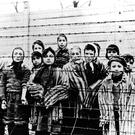 Anniversary: A photo taken just after the liberation of Auschwitz by the Soviet army in January, 1945, shows a group of children in the striped camp prisoners' uniform. AP Photo