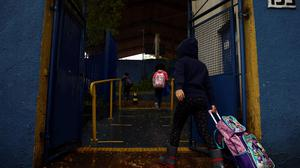 Students need schools to be open. Photo: Carla Carnie/Reuters