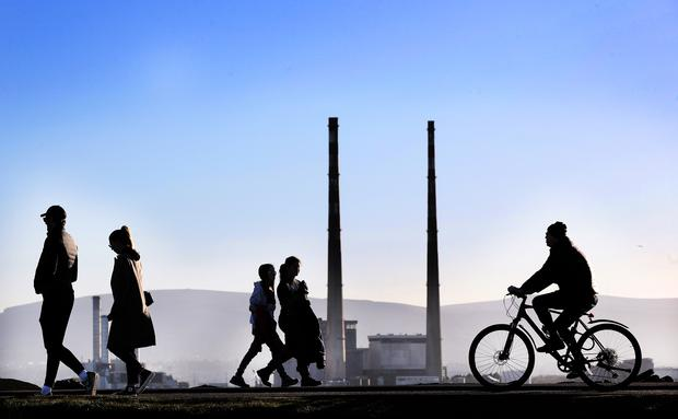 People strolling and cycling along the coast at Dollymount during recent sunny weather in Dublin. Photo: Steve Humphreys