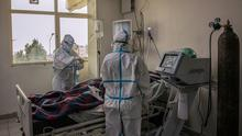 Tip of the iceberg: Doctors in PPE check on a Covid-19 patient in the intensive care unit at Saint Petros Hospital in Addis Ababa, Ethiopia. Photo: Amanuel Sileshi / AFP