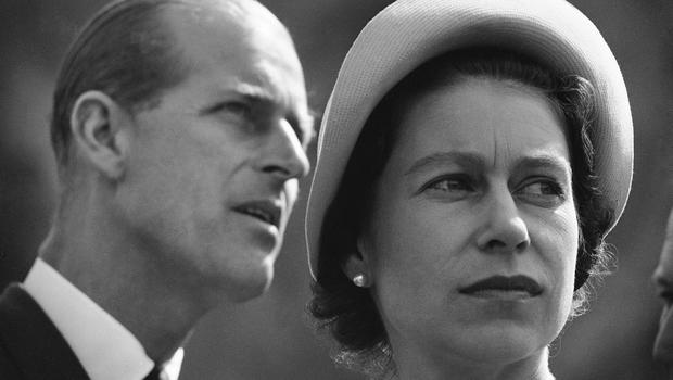 In this June 20, 1959 file photo, Britain's Queen Elizabeth and Prince Philip are pictured in Schefferville in Quebec as they listen to an explanation on the workings of an iron ore mine on another stop in their royal tour of Canada. (AP Photo/File)