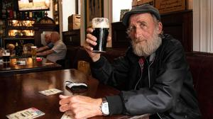 Called to the bar: Jimmy Nooks enjoys a pintin Slattery's Bar on Capel Street, Dublin, yesterday as pubs and restaurants reopened fully across Ireland. Photo: Damien Eagers/PA