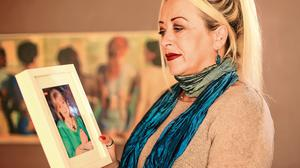 Compassion: Activist Gail O'Rorke with a picture of her friend Bernadette Forde, whom she helped. Photo: Gerry Mooney