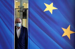 Virus impact: Irish European Commissoner for Trade Phil Hogan wearing a face mask at the European Commission in Brussels. Photo: Johanna Geron/Reuters