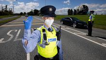 Slow lane: Gardaí conduct a checkpoint outside Naas, on Saturday as hopes for a return to normal life in Kildare, Laois and Offaly vanish. Photo: Mark Condren