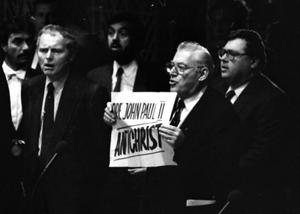 Ian Paisley holding up a sign as he denounces the Pope's speech to the European Parliament in Strasbourg in 1988. Photo: Reuters