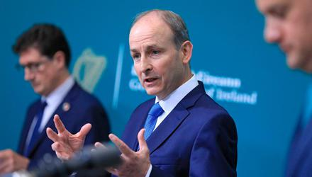 Taoiseach Micheál Martin (centre) with Tánaiste Leo Varadkar (right) and Minister Eamon Ryan (left). The Coalition has gone gung-ho on its recovery plan. Photo: Julien Behal/PA Wire