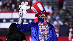 Supporters of President Donald Trump gather for a campaign rally at Opa-Locka Executive Airport, Florida, Fla. Photo: AP/Jim Rassol)