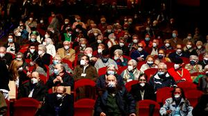 Nursing home residents and workers, who have received the second dose of the Pfizer-BioNTech vaccine, attend a special theatre show in Madrid, Spain. Photo: Reuters/Sergio Perez