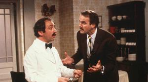 John Cleese and Andrew Sachs as Manuel and Basil in Fawlty Towers. Photo: PA/BBC