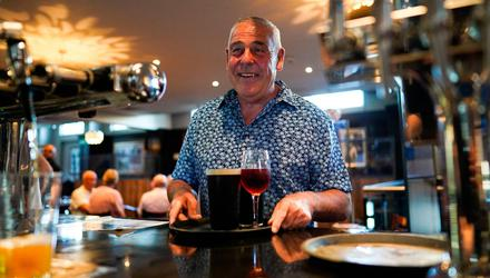 Happy days: A man orders drinks from the bar in the Mile Castle pub in Newcastle on 'Freedom Day' July 19 when England dropped most of its Covid restrictions