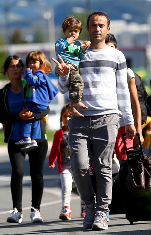 Migrants walk towards Germany at the border crossing with Austria