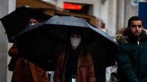 A woman wearing a mask in London. Photo: PA