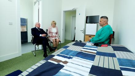 President Higgins and his wife Sabina withFrank Kirwanat Carraig Eden, whichis used by Tiglin to provide accommodationfor people who have completed an addiction rehabilitation programme. Picture byMaxwells
