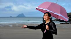 Weathering the storm: Met Eireann's Jean Byrne, pictured here in Co Kerry, is one of the meteorologists routinely castigated by amateur forecasters. Pic. Don MacMonagle