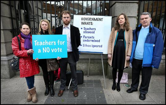 The Teachers for a No Vote group outside Dáil Éireann, including from left, parent Judith Dunne from Bray, parent Dr Helena Smith from Dún Laoghaire, spokesperson Kevin Leavy from Roscommon, teacher Clar Ní Cheallacháin from Sandyford and Dr John Murray from the Iona Institute. Photo: Steve Humphreys