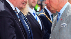 Prince Charles, Prince of Wales meets Deputy First Minister Martin McGuinness during a visit to St Patricks Church on May 21 in Belfast, Northern Ireland