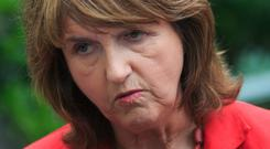 Tánaiste Joan Burton promised not to implement harsh reforms without adequate childcare provision