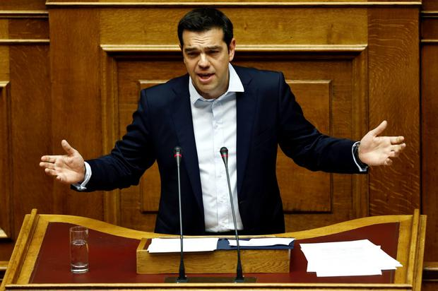 Greek Prime Minister Alexis Tsipras delivers a speech during a parliamentary session in Athens