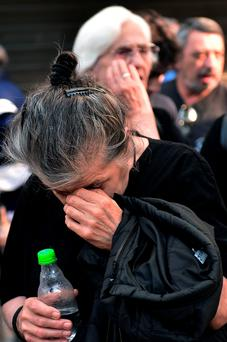 A pensioner becomes emotional outside a closed branch of the national bank of Greece in Athens: nearly 50pc of pensioners live below the poverty line in Greece on pensions of less than €700 per month