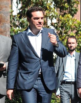 Greece's Prime Minister Alexis Tsipras leaves after a meeting with Greek political party leaders at the Presidential Palace in Athens