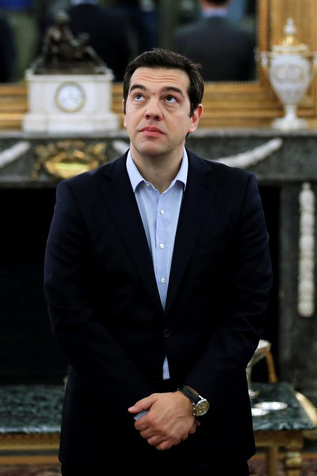 Greek Prime Minister Alexis Tsipras looks on during a swearing in ceremony of members of his government at the Presidential Palace in Athens, Greece. New ministers in Tsipras' government were sworn in on Saturday after a reshuffle expelled dissidents from his cabinet and began a new phase of negotiations for a third bailout package (REUTERS/Alkis Konstantinidis)