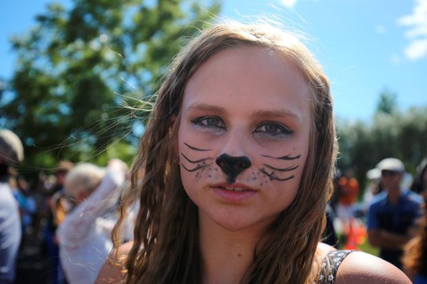 A girl protests against the killing of Cecil the lion by hunter Walter Palmer