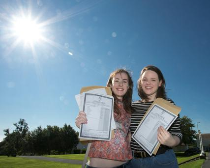 Hannah Dillion and Sarah O'Neill celebrate in the sunshine after receiving their Leaving Cert results at St Mary's College, Arklow, Co Wicklow.