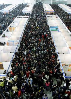 Crowds throng to a job hiring conference in Beijing. Even a fraction of Asian investment would boost economy
