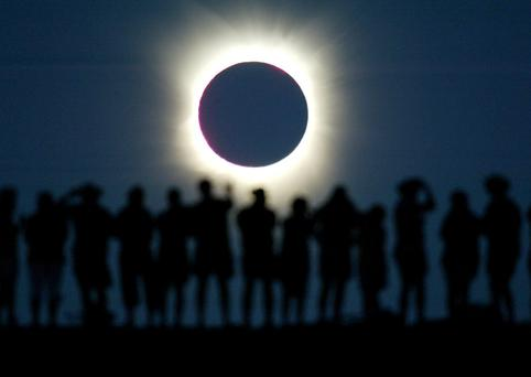 THIS IS THE END, BEAUTIFUL FRIEND: 'Death can be a journey to forgiveness, acceptance, awareness, even bliss'. Watchers observe a total solar eclipse in the Australian outback in 2002