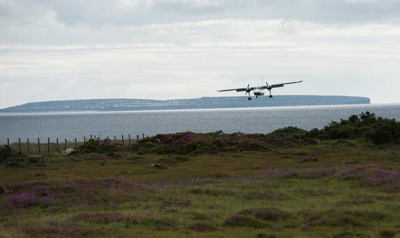 An Aer Arann flight lands in Connemara with Inis Mor in the background.