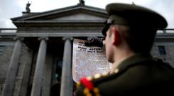 Time for reappraisal: Captain Eoin Rochford of the Defence Forces reads the Easter Proclamation outside the GPO