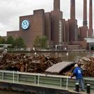 Company town: Scrap metal lies in a boat in front of the Volkswagen power plant in Wolfsburg
