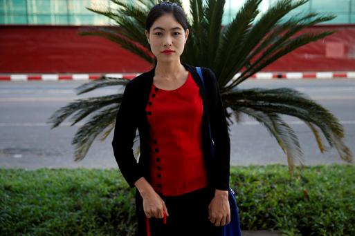 First-time voter Ma Yee Yee Cho, 23, poses for a picture on the way to her job, in Yangon, Myanmar. Photo: Reuters