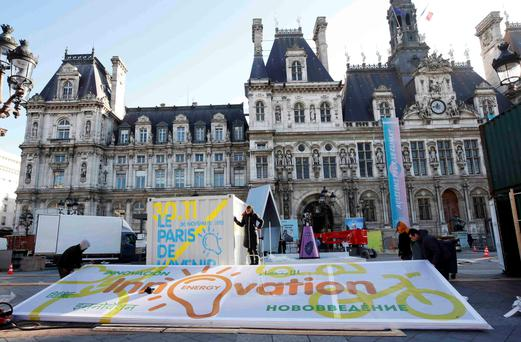 People put the final touches to an installation for the 'Paris de L'Avenir', a showcase for climate solutions ahead of the World Climate Summit, in front of Paris City Hall