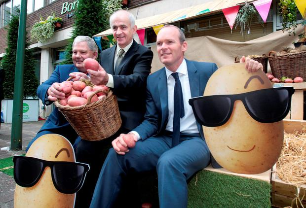 No small potatoes: Eddie Downey, former IFA president, centre, with Michael Hoey of the Potato Federation, left, and Agriculture Minister Simon Coveney