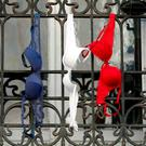 Blue, white and red brassieres hang from a balcony in Marseille, France, after citizens were urged to hang the tricolour from their windows
