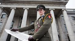 SENTIMENT: Captain Kate Hanrahan with the Proclamation outside the GPO at the 99th anniversary of the 1916 Rising. Photo: Mark Condren