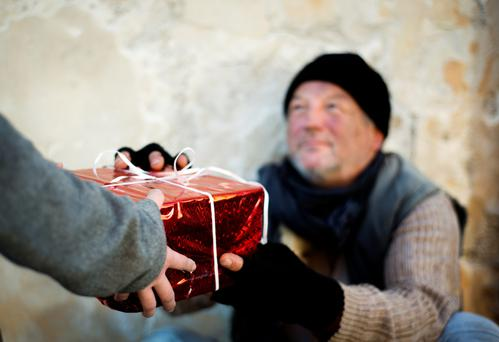 Christmas is a terrible time to be lonely, but the most simple of all gifts – one's company – can bring cheer into many people's lives. Picture is posed