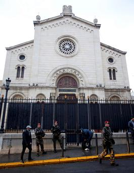 Armed French soldiers stand in front of a Synagogue during a visit of French Interior Minister Bernard Cazeneuve after an attack in front of a Jewish school in Marseille's 9th district. Photo: Reuters