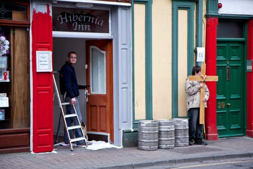 A man takes advantage of Good Friday to do some decorating at a pub in Tuam, the day the nation's hostelries are traditionally closed for business. But there are growing calls for the laws to be changed, with some citing them as outdated. Photo: Andy Newman