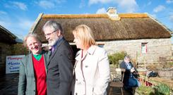 Gerry Adams with Rose Conway Walsh, the SF candidate for Mayo, with Tom Hennigan at Hennigan's Heritage Farm in Swinford, Co. Mayo. Photo: Keith Heneghan