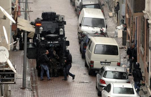 Security forces take position during an operation against two attackers in Istanbul yesterday, during which two women, who had hidden inside a building after attacking police with gunfire and a hand grenade. Photo: AP
