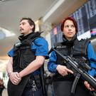 Police officers stand guard at the Airport of Zurich, Switzerland, as flights were cancelled all over Europe following the attacks at Brussels Zavantem Airport and on the metro system. Photo: Ennio Leanza/Keystone