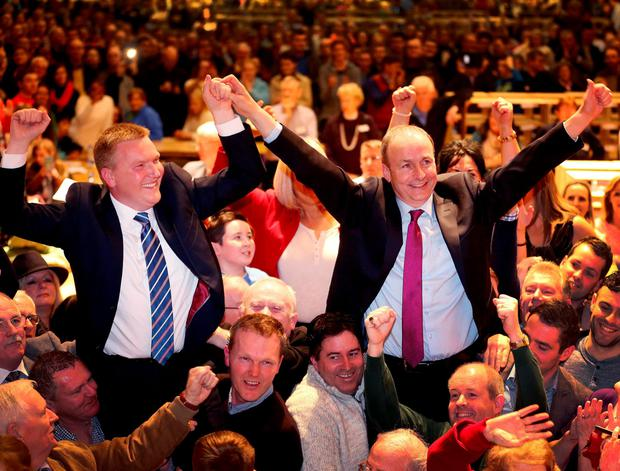 Fianna Fáil's Michael McGrath and Micheál Martin celebrate their re-election in Cork South Central, where they together pulled 41.6pc of the vote. Photo: PA