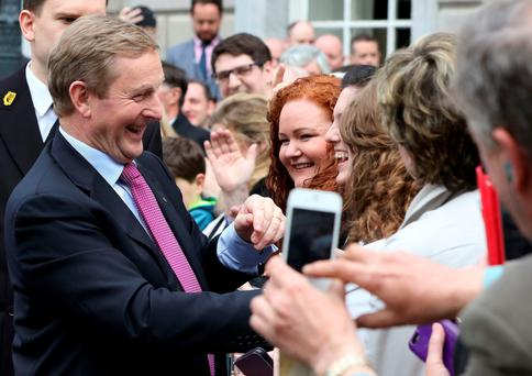 February 26, 2016: Taoiseach Enda Kenny is congratulated as he leaves Leinster House after his historic re-election Photo: Paul Faith